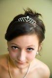 美丽的女孩查出青少年的珠宝 免版税库存照片