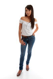 美丽的女孩牛仔裤皮包骨头顶部佩带 库存照片