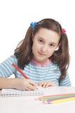 美丽的女孩画与颜色铅笔 免版税库存图片