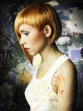 美丽的女孩画家 免版税库存图片