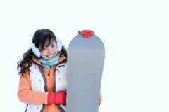 美丽的女孩笑的挡雪板 图库摄影