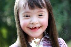 美丽的女孩纵向有花的 图库摄影