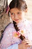 美丽的女孩纵向有长的辫子的 库存照片