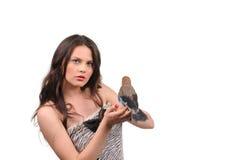 美丽的女孩纵向有鸟的 库存照片