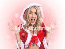 美丽的女孩,圣诞老人衣裳。概念- 库存图片