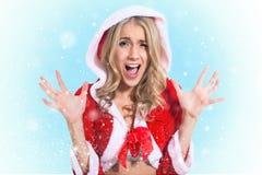 美丽的女孩,圣诞老人衣裳。概念- 库存照片