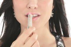 美丽的女孩绘有唇膏的嘴唇 beauvoir 免版税库存照片