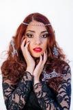 美丽的女孩画象有冬天装饰的在她的头发 免版税库存照片