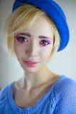 年轻美丽的女孩画象有桃红色构成的 免版税图库摄影