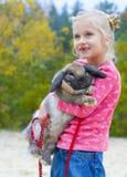 美丽的女孩画象用兔子 库存图片