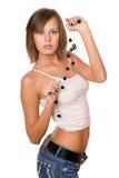美丽的女孩画象白色上面和牛仔布短裤的 库存图片