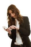 美丽的女实业家在计算器计算 免版税库存图片