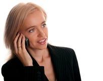 美丽的女实业家移动电话 免版税库存图片