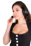 美丽的女实业家耳机 免版税库存图片