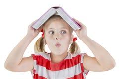 美丽的女小学生拿着书 图库摄影