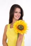 美丽的女性向日葵年轻人 免版税库存照片