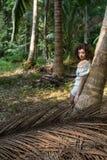 美丽的女性在热带密林 图库摄影