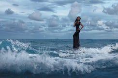 美丽的女性画象在海洋 库存图片