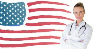 美丽的女性医生的综合图象有胳膊的在医院横渡了 免版税图库摄影