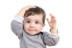 美丽的女婴用在头的手 库存照片