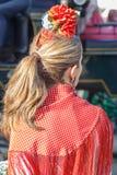 美丽的妇女佩带的佛拉明柯舞曲礼服 西班牙民间传说 免版税库存照片