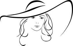 美丽的妇女剪影一个典雅的帽子的 图库摄影