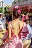美丽的妇女在传统服装穿戴了在塞维利亚` s 4月市场 库存照片