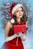 美丽的妇女在圣诞老人礼服 免版税库存图片