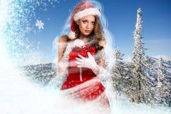 美丽的妇女在圣诞老人礼服 库存照片