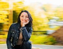 美丽的妇女在秋天 免版税库存图片