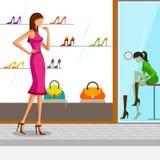 美丽的妇女尝试的鞋子 免版税库存图片
