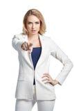 年轻美丽的妇女把她的手指指向您轻的背景的 免版税图库摄影