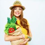美丽的妇女用绿色食物 免版税库存图片