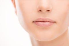 美丽的妇女的嘴唇特写镜头 免版税图库摄影