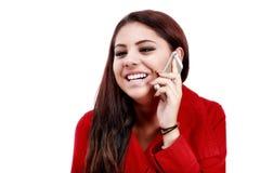 美丽的妇女满意对她巧妙的电话 库存照片