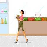 美丽的妇女购物菜 库存照片
