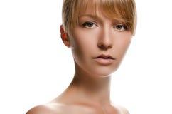 年轻美丽的妇女画象白色背景的 免版税图库摄影