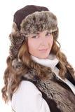 年轻美丽的妇女画象裘皮帽和背心的隔绝了o 库存照片