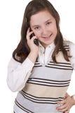 美丽的学校女孩谈话在手机 免版税库存图片