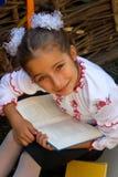 美丽的小女孩在刺绣的7年预定 免版税库存照片