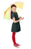 美丽的小女孩纵向有伞的 库存图片
