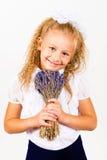 美丽的小女孩画象有花花束的  库存图片