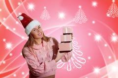 美丽的小姐的图片圣诞老人红色帽子的 免版税库存图片