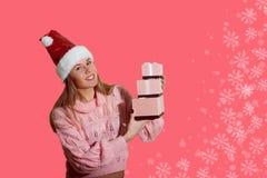 美丽的小姐的图片圣诞老人红色帽子的 库存图片