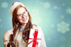 美丽的小姐的图片圣诞老人红色帽子的 图库摄影