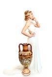 美丽的少妇称呼了与油罐的希腊语在白色backgr 免版税库存照片