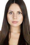 美丽的少妇纵向有长的深色的头发的 免版税库存照片