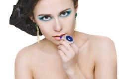 妇女接触嘴唇 免版税库存图片