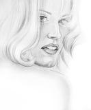 美丽的少妇画象有长的头发的 免版税库存照片