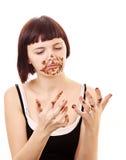 美丽的巧克力吃暴食者年轻人 免版税库存图片